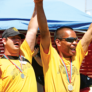 Photo of Special Olympics Athletes cheering after receiving medals
