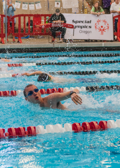 Special Olympics Oregon athlete swimming in competition