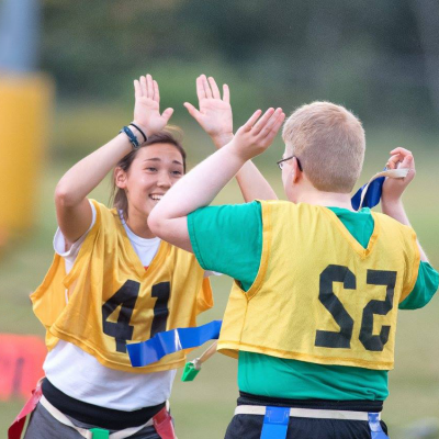 Photo of a Unified athlete hi-fiving a Unified partner