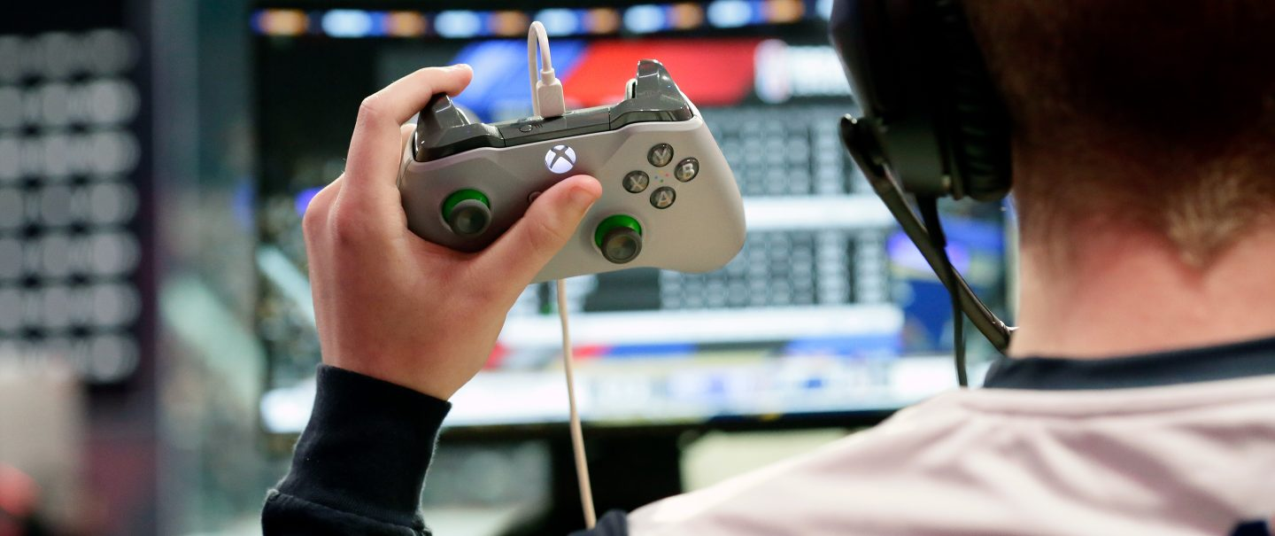 Image of player holding xbox controller